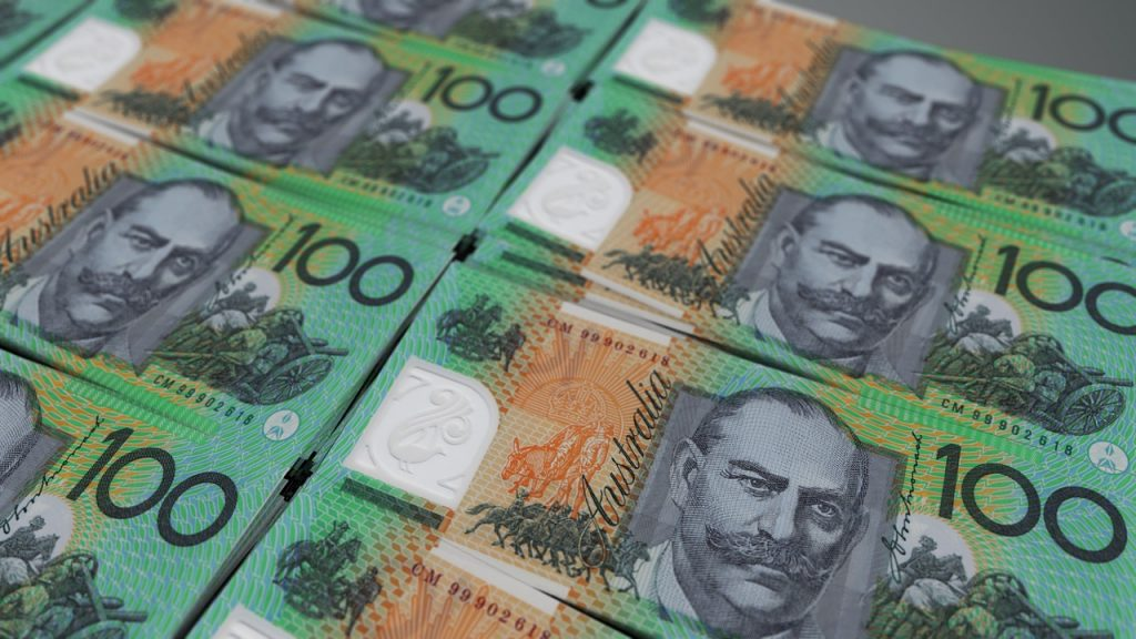 pile of australian 100 dollar notes