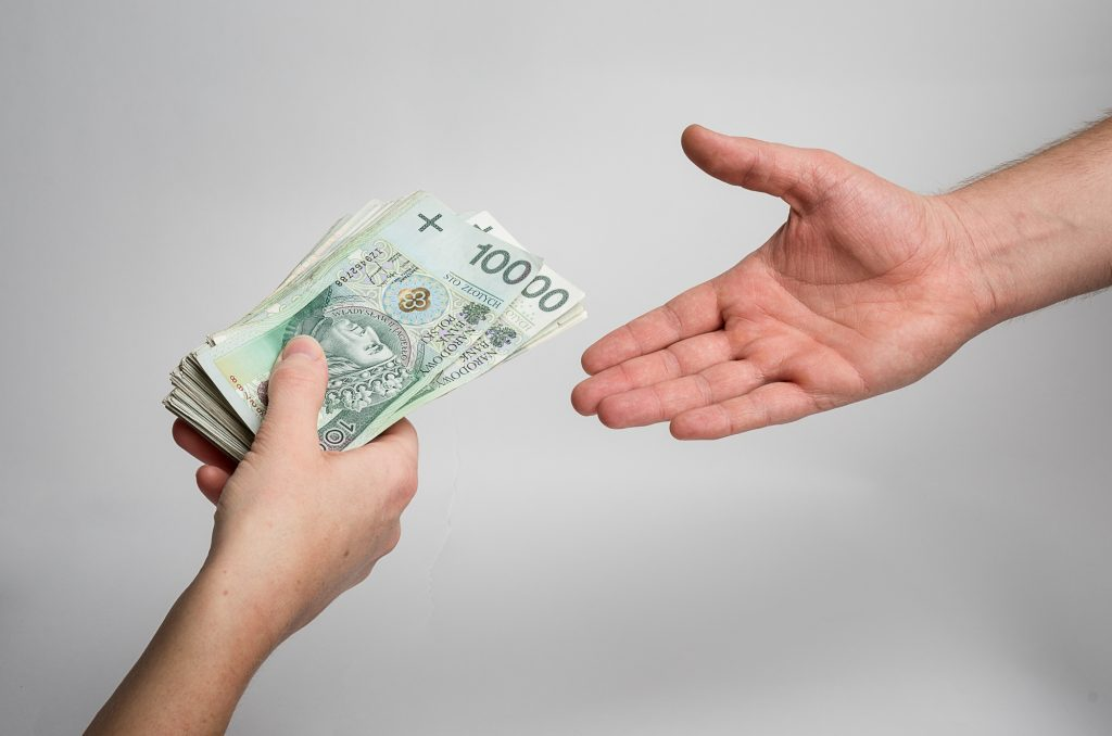 handing money to someone else hands